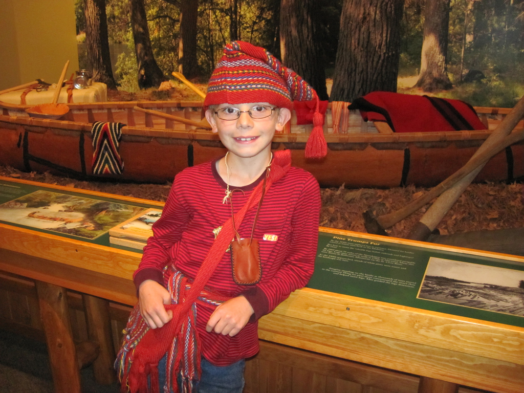 A Junior Ranger dresses as a voyageur