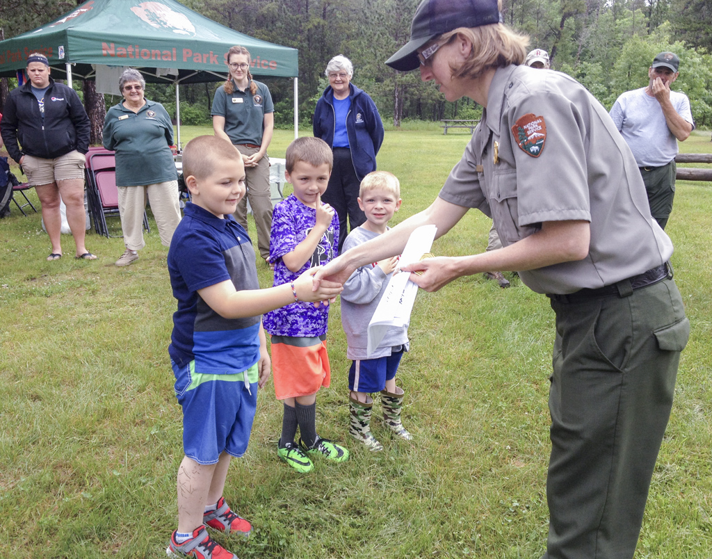 Junior Rangers receiving their certificates during the Active Duty Service Program at Earl Landing on the Namekagon River