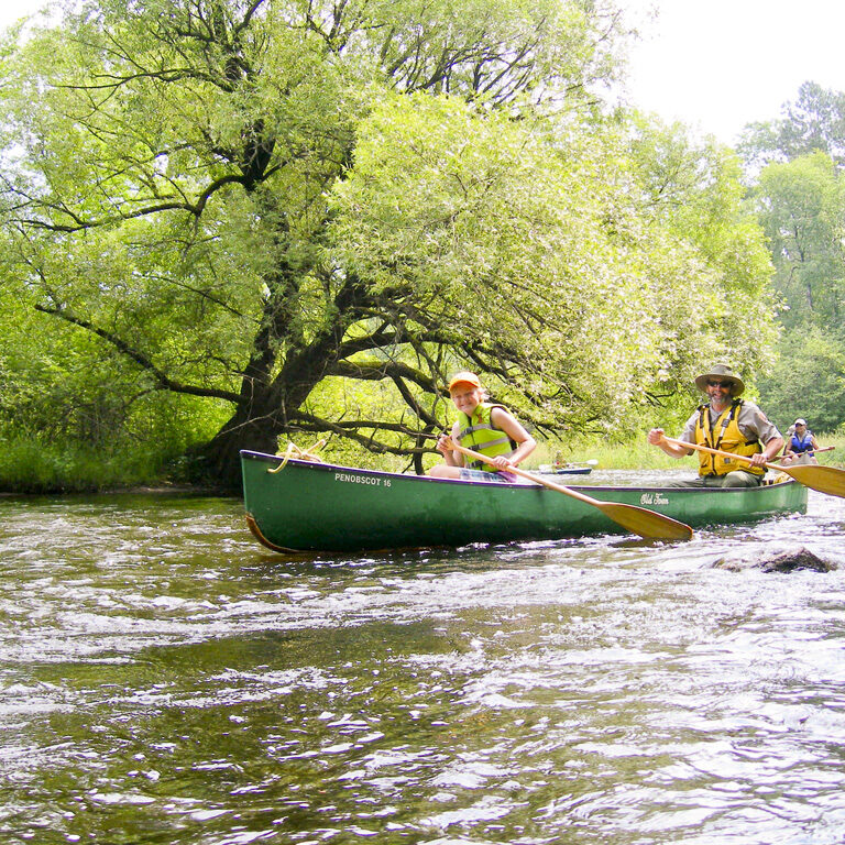 Participants canoeing in the Veteran's Paddle event on the Namekagon River